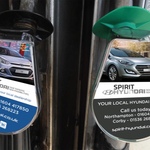 Fuel filler cap advertising for car dealer